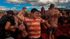 "People participate in the tenth annual tomato fight festival, known as ""Tomatina"", in Sutamarchan, Boyaca department, Colombia, on 2 June 2019."