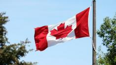 A Canadian flag flies in the breeze