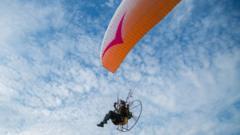 Sacha Dench flying her paramotor
