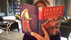 Someone holding a Harry Potter Book