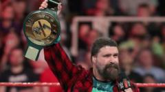 WWE Hall of Famer Mick Foley holding the all-new 24/7 Championship belt