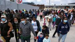 Migrants attend a demonstration at the San Ysidro crossing port asking US authorities to allow them to start their migration process in Tijuana, Baja California state, Mexico on March 23, 2021