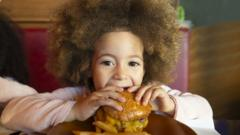 Child-eating-burger.
