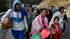 Venezuelans heading to Peru walk along the Panamerican highway in Tulcan, Ecuador