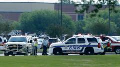 Emergency services outside the school in Santa Fe