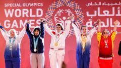 Athletes receiving their medals during declaration ceremony at the Special Olympics World Games in Abu Dhabi