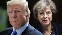 Donald Trump looks stern as Theresa May looks out into the distance behind him
