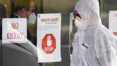 A person in PPE outside an aged care home in Melbourne