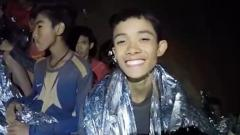 A video grab handout made available by Thai Royal Navy shows some of the members of a trapped soccer team in a section of Tham Luang cave in Khun Nam Nang Non Forest Park