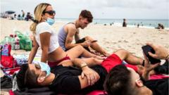 People relax on Miami Beach