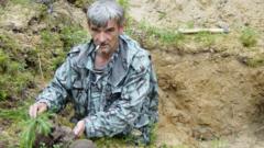 Yuri Dmitriev with victims' skulls at mass grave