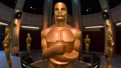 An Oscars statue stands at the end of the red carpet arrivals area ahead of the 89th annual Oscars at the Dolby Theatre in Hollywood, California