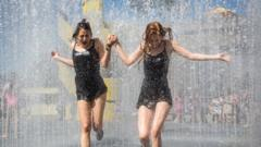 People cool off in a fountain outside the Southbank Centre on June 30, 2015 in London, England