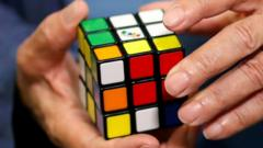 Erno Rubik, the creator of the puzzle, solves a Rubik's cube as he poses during the world's largest Rubik's Cube championship in Aubervilliers, near Paris, France,