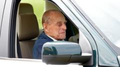 Pince Philip shown in car driving seat
