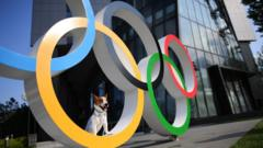 dog-sitting-in-olympic-rings