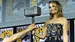 Natalie-Portman-receiving-Thor-Hammer.