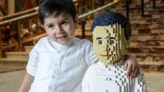 Sunay Urs alongside the Lego model of himself.