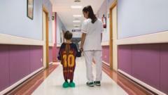 Boy wears football shirt hospital gown