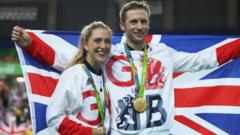 Laura Trott and Jason Kenny pose with GB flag