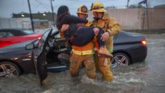 Firefighters save woman from her car