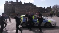 Officers from Police Scotland dancing for the Running Man Challenge