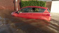 Car in the floods in Carlisle in Cumbria