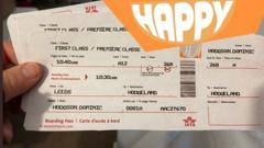 A fake plane ticket and the Happy logo