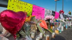Flowers-and-signs-at-makeshift-memorial-in-El-Paso.