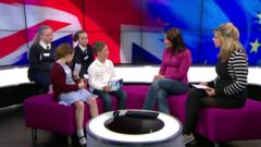 Katya and Jenny with children in the Newsround studio.