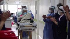 Hospital staff clap for 104-year-old who beat coronavirus twice