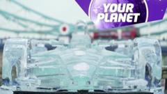An ice sculpture of a racing car and the Your Planet logo