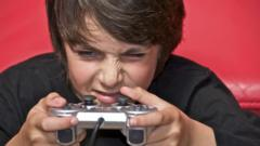 Image of a child concentrating with a games controller in his hand