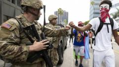 a protestor fist bumps a national guardsman