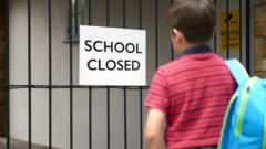 boy looking at school closed sign on school gates