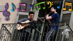musicians-play-guitar-and-flute-on-their-balcony-during-coronavirus-self-isolation.