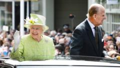The Queen and Prince Philip great the crowds in Windsor.