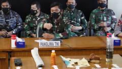 Indonesian naval officers with debris believed to be from the missing Indonesian sub - Bali, 24 April