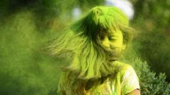 Child with coloured powder in her hair