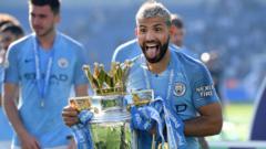 Sergio-Aguero-with-Premier-League-trophy