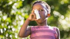 Boy using an inhaler