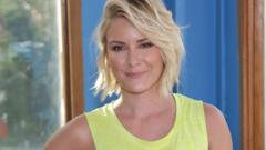 Renee Young smiling at the camera.
