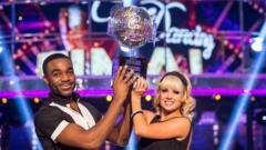 Ore and Joanne lift the glitter ball