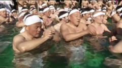 People taking an ice bath in Japan