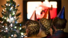 Kids watch TV at Christmas time