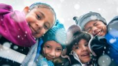 four-children-look-at-camera-as-snow-falls.