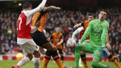 Eldin Jakupovic saves from Alexis Sanchez