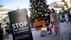 Coronavirus-sign-with-a-family-and-Christmas-tree-in-the-background.