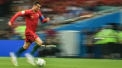 Cristiano Ronaldo running with football