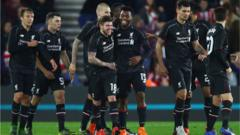 Daniel Sturridge celebrates with his team mates